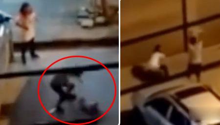 男子街头打妻摔娃怒砸地砖