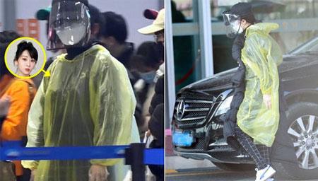 杨紫身穿雨衣现身机场