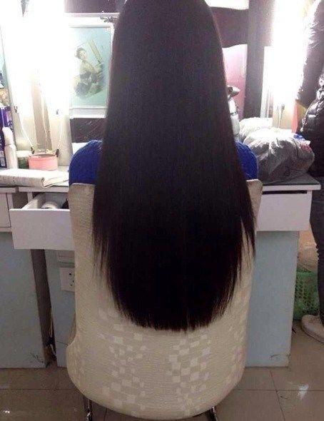 这头发应该拉过的,这么好看,首先她的发质还可以,然后就是理发师剪得图片