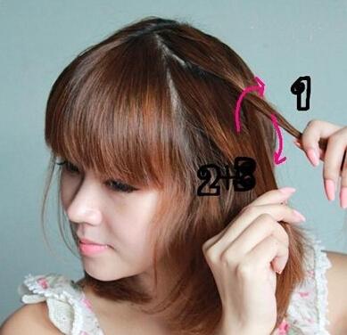 扎齐肩中短发的步骤: 1,首先从头顶的一侧取出少量头发,然后将头发图片