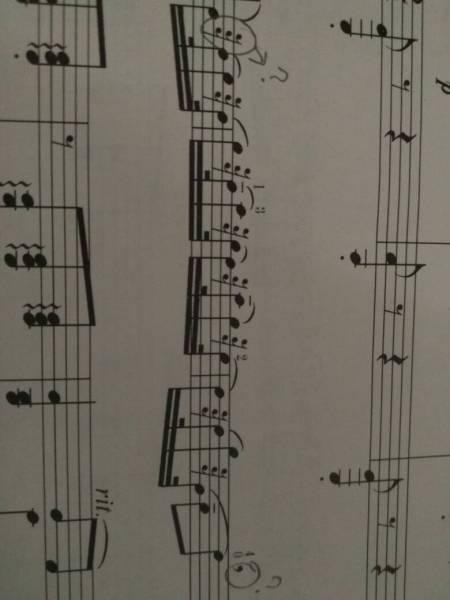 这两个打了问号的符号怎么拉 是什么(小提琴五线谱)图片