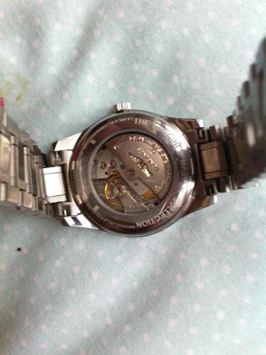 朋友送我一只浪琴手表但我不知道手表是真表还是是l图片